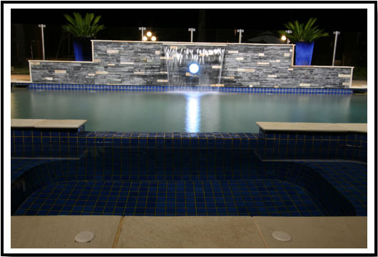Elegant inground pool with water feature